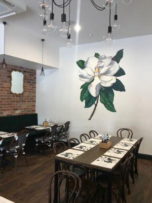 Magnolia mural at Lady Marmalade Cafe. Kat's Mural Art. Kat Smirnoff